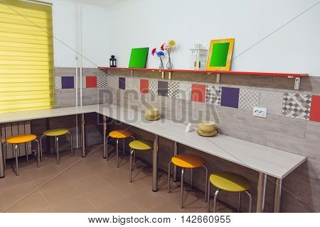 The Hostel interior - kitchen. table, chair, crockery