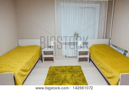 The hostel interior - bedroom. double bed. beautiful interior