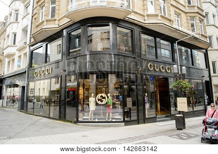 LUXEMBOURG LUXEMBOURG - JUN 05 2016: People admiring and buying goods inside luxury fashion GUCCI store in central Luxembourg on 16 Rue Philippe II
