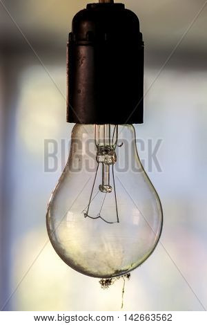 Hanging Dusty Light Bulb