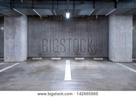 empty Parking garage underground, interior shopping mall at night