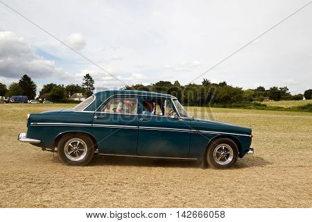 POTTEN END, UK - JULY 27: A preserved 3.5L Rover sportscar heads toward the main show arena to give a public demonstration at the Dacorum Steam & Country fair on July 27, 2014 in Potten End