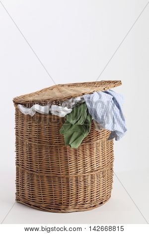 rattan laundry basket on the white background