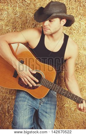 Country music man playing guitar
