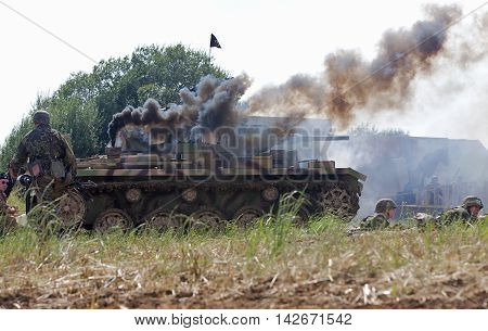 WESTERNHANGER, UK - JULY 19: A German panzer tank is set ablaze by allied fire during a WW2 battle re-enactment at the W&P show on July 19, 2014 in Westernhanger