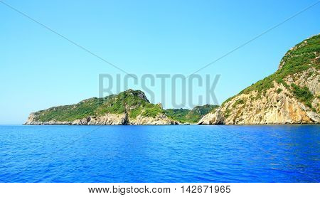 Coast With A Mountain Chain And A Secret Bay On Corfu Island