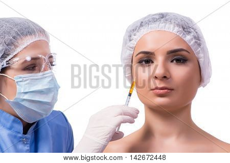 Young woman preparing for injection of botox isolated on white