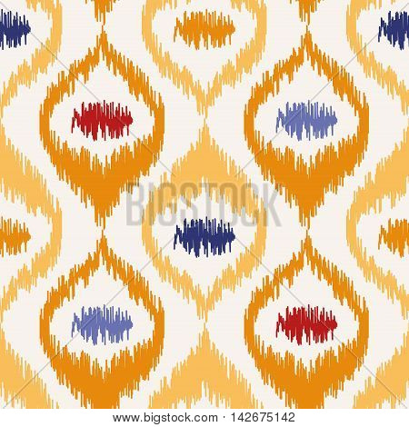 Seamless geometric pattern, based on ikat fabric style. Vector illustration. Oriental rug pattern, in yellow, orange and red. Yellow ogee pattern.