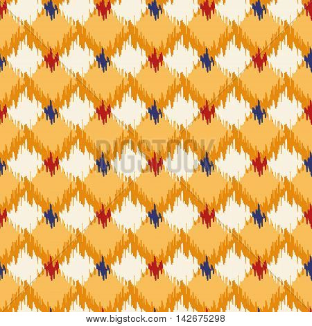 Seamless geometric pattern, based on ikat fabric style. Vector illustration. Oriental rug pattern, in yellow, orange and red. Checkered geometric pattern for comforter.