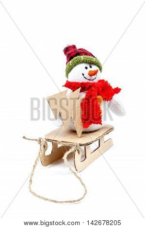 Snowman on a sled with Christmas tree isolated on a white background.