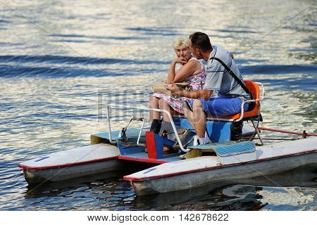 Orel Russia - August 05 2016: Orel city day. Couple sitting in pedal catamaran horizontal