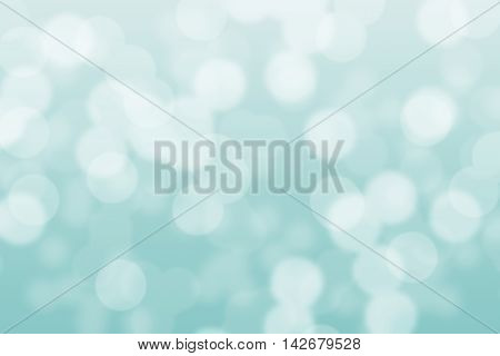 Abstract circular light blue turquoise bokeh background