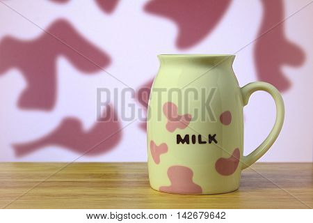 Milk cup on table (Pink cow milk pattern)