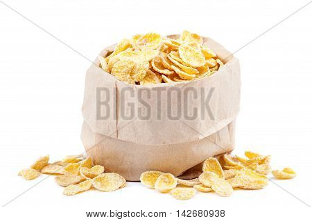 Cornflakes in a paper bag isolated on white background.