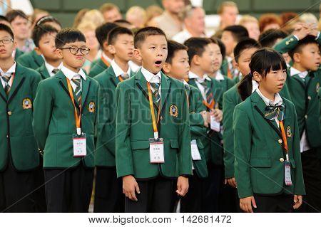 Orel Russia - August 04 2016: Brass bands fest. Choir of Chinese children in green uniform