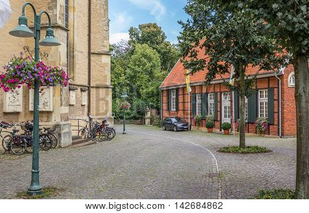 TELGTE, GERMANY - AUGUST 7, 2016: Cobblestones street in the historical center of Telgte, Germany