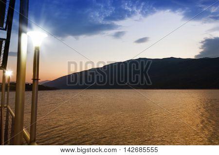 lake between kosovo and albania in beautiful sunset