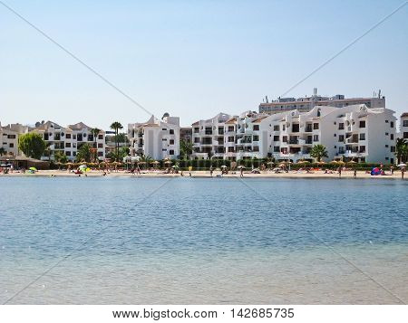 Alcudia Majorca Spain - June 26 2008: Beach of Alcudia with hotels promenade - water of mediterranean sea in front