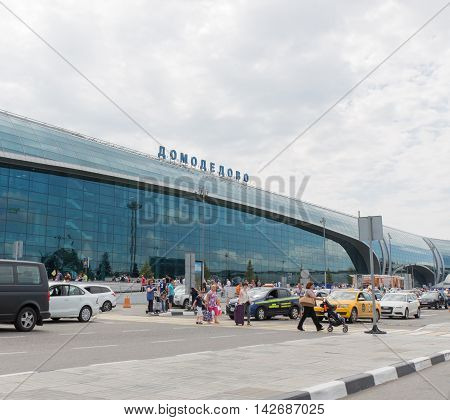 The Moscow region - 31 July 2016: Large modern passenger terminal at Domodedovo airport waiting for passengers cars and a lot of people with suitcases 31 July 2016 Moscow region Russia