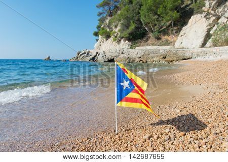 Catalan flag at beach in Catalunya