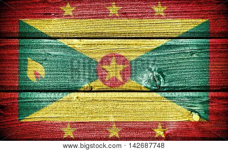 flag of Grenada painted on old grungy wooden background: 3d illustration