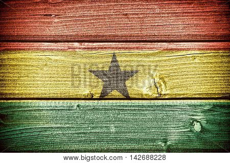 Flag of Ghana painted on old grungy wooden background: 3d illustration