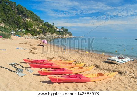 Yellow canoes at the Spanish beach