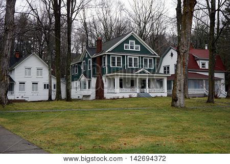An elegant green and white home on Pennsylvania Avenue in Wequetonsing, Michigan.