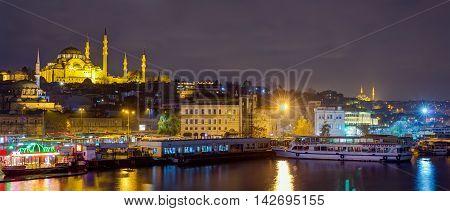 Panoramic view of Eminonu at night with Suleymaniye Mosque, Istanbul, Turkey