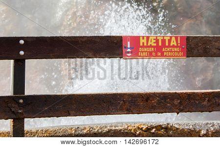 Danger - boiling watter sign. Boiling geothermal hot spring Deildartunguhver in Reykholtsdalur Iceland