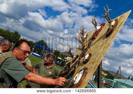 Perekhrest Ukraine - August 14. 2016: The jury evaluates the trophies during the first festival of hunters.