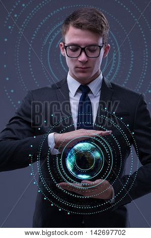 Young businessman in globalisation concept holding earth