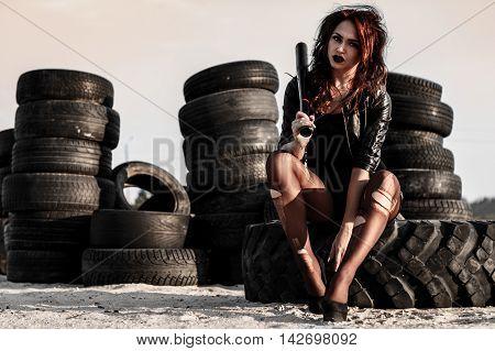 Disheveled Redhead Woman With A Baseball Bat