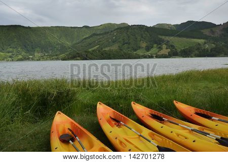 kayak and canoe sport at Blue Lake or Lagoa Azul in Sete Cidades at Sao Miguel Azores island in Portugal in tourist holiday destination landmark and vacation travel adventure concept