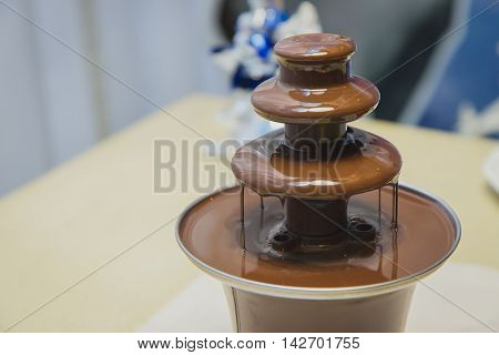 Chocolate fountain on table in wedding banquet