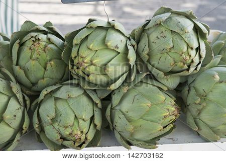 Artichokes in bulk on a rural market.