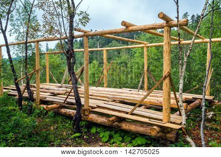 Installation Of Wooden Beams From Logs