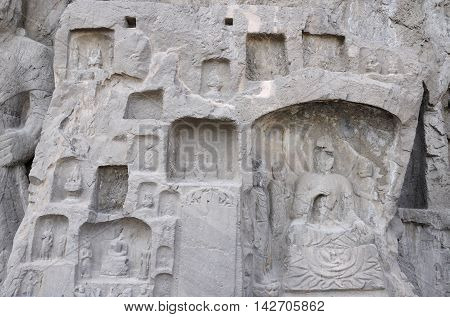 Ancient Buddha carvings and caves with longmen grottoes in Luoyang China in Henan Province.