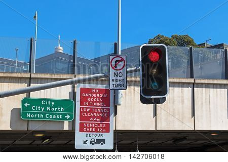 Road sign : No dangerous goods in tunnel, low tunnel clearance before entering the tunnel in Sydney, Australia