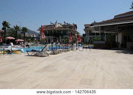 CALIS, TURKEY, 28TH MAY 2016: A local family run hotel business with the swimming pool in the foreground in calis ,turkey, 28th may 2016