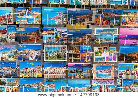 Menton France - July 30 2016: postcards at a souvenir shop in Menton. Menton is a popular seaside resort at the French Riviera near the Italian border