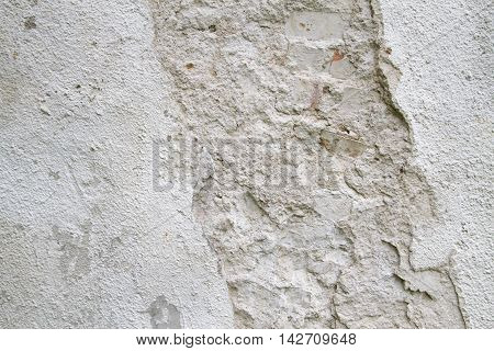 Old white scratched rough concrete wall texture for background