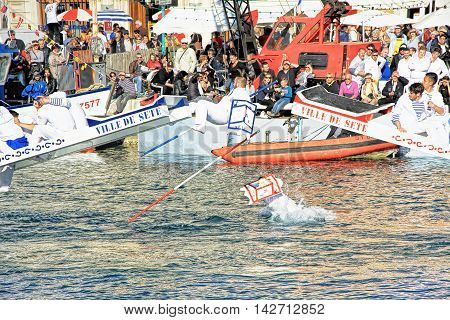 SETE, FRANCE - March 26 2016: Water Jousting performance during Stopover in Sete - Maritime Traditions Festival from the 22 to 28 march 2016 at the streets of Sete South of France