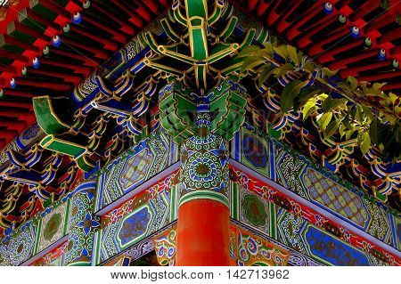 Xi'an China - September 8 2006: Hand-painted decorative panels and interlocking woodwork ceiling at a pavilion of the Da Xing San Temple dating to 265 A. D.