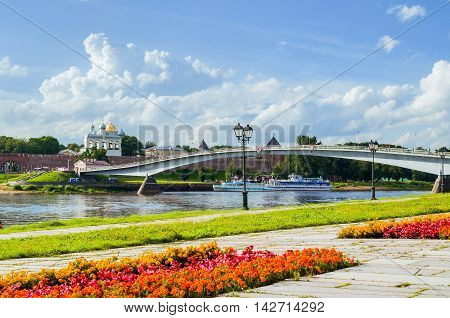 VELIKY NOVGOROD RUSSIA - AUGUST 5 2016. Novgorod Kremlin and embankment near the Volkhov river in summer cloudy day. Selective focus at the Kremlin