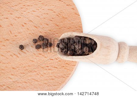 Black Peppercorns In A Wooden Spoon