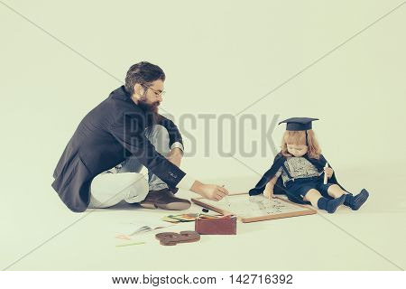 Small Boy Drawing With Professor