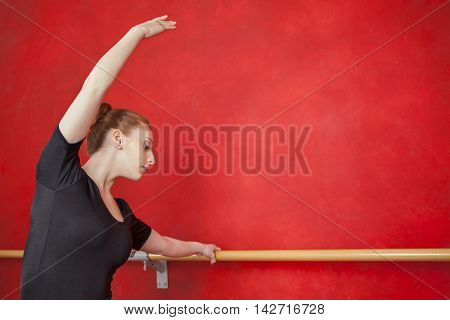 Ballerina Practicing Her Dance Moves At Barre