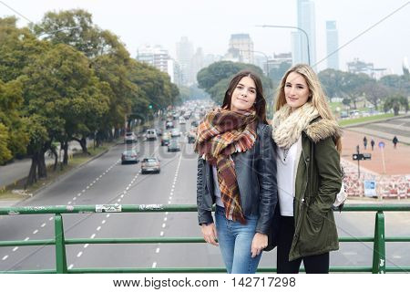 Portrait of two beautiful young woman. Urban concept. Outdoors.