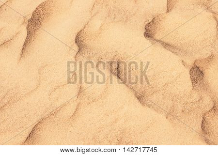 Desert sand abstract background in shades of yellow